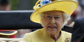 FILE - This is a Tuesday, June, 14, 2016  file photo of Britain's Queen Elizabeth II as she arrives by carriage on the first day of the Royal Ascot horse race meeting at Ascot, England. Buckingham Palace officials said Wednesday Dec. 21, 2016 that Queen Elizabeth II and her husband Prince Philip have delayed their planned Christmas trip because both are suffering from heavy colds.  (AP Photo/Alastair Grant/file)